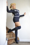 Danni King Strips Off Her Tight Uniform And Slips Off Her Pretty Lingerie Leaving Her In Just Her Over The Knee Socks. - Picture 2