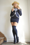 Danni King Strips Off Her Tight Uniform And Slips Off Her Pretty Lingerie Leaving Her In Just Her Over The Knee Socks. - Picture 1